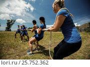 Купить «People playing tug of war during obstacle training course», фото № 25752362, снято 24 ноября 2016 г. (c) Wavebreak Media / Фотобанк Лори