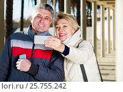 Купить «Mature couple doing selfie», фото № 25755242, снято 21 октября 2018 г. (c) Яков Филимонов / Фотобанк Лори