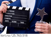 Купить «Handsome man with movie clapper isolated on white», фото № 25763518, снято 5 ноября 2016 г. (c) Elnur / Фотобанк Лори