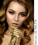 Купить «Beauty portrait of young woman with golden makeup», фото № 25765774, снято 13 января 2017 г. (c) Людмила Дутко / Фотобанк Лори