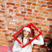Young girl indulges in a Christmas hat, фото № 25771606, снято 24 декабря 2016 г. (c) Афанасьева Ольга / Фотобанк Лори