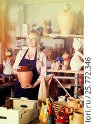 Купить «Young woman carrying ceramic vessels», фото № 25772346, снято 24 февраля 2019 г. (c) Яков Филимонов / Фотобанк Лори