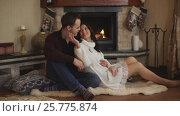Купить «Beautiful couple in love near fireplace», видеоролик № 25775874, снято 25 января 2017 г. (c) Виктор Аллин / Фотобанк Лори