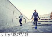 Купить «man and woman exercising with jump-rope outdoors», фото № 25777158, снято 17 октября 2015 г. (c) Syda Productions / Фотобанк Лори