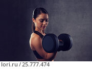 Купить «young woman flexing muscles with dumbbells in gym», фото № 25777474, снято 12 декабря 2015 г. (c) Syda Productions / Фотобанк Лори