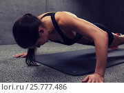 Купить «woman doing push-ups in gym», фото № 25777486, снято 12 декабря 2015 г. (c) Syda Productions / Фотобанк Лори