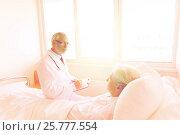 Купить «senior woman and doctor with clipboard at hospital», фото № 25777554, снято 11 июня 2015 г. (c) Syda Productions / Фотобанк Лори