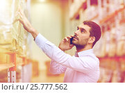 Купить «serious man calling on smartphone at warehouse», фото № 25777562, снято 9 декабря 2015 г. (c) Syda Productions / Фотобанк Лори