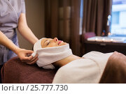 Купить «woman having face massage with towel at spa parlor», фото № 25777730, снято 26 января 2017 г. (c) Syda Productions / Фотобанк Лори