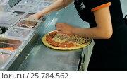 Купить «Making pizza at kitchen», видеоролик № 25784562, снято 18 марта 2017 г. (c) Сергей Кальсин / Фотобанк Лори