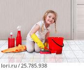Купить «Little girl helps with the cleaning in the house. Child happily washing floors», фото № 25785938, снято 21 октября 2018 г. (c) Ирина Козорог / Фотобанк Лори