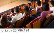 Купить «Glad audience expecting movie to begin», фото № 25786194, снято 3 декабря 2016 г. (c) Яков Филимонов / Фотобанк Лори