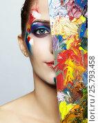 Купить «Young female painter with color palette and acrylic paint on face», фото № 25793458, снято 5 февраля 2017 г. (c) Serg Zastavkin / Фотобанк Лори
