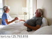 Купить «Senior woman giving medicine to senior man in the bedroom», фото № 25793818, снято 29 ноября 2016 г. (c) Wavebreak Media / Фотобанк Лори