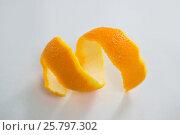 Купить «Close-up of spiral orange peel», фото № 25797302, снято 19 декабря 2016 г. (c) Wavebreak Media / Фотобанк Лори