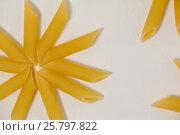 Купить «Flowers formed of pennette pasta», фото № 25797822, снято 13 октября 2016 г. (c) Wavebreak Media / Фотобанк Лори
