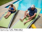Senior couple using digital tablet on lounge chair. Стоковое фото, агентство Wavebreak Media / Фотобанк Лори