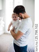 Купить «Father holding his crying baby girl», фото № 25798102, снято 29 ноября 2016 г. (c) Wavebreak Media / Фотобанк Лори