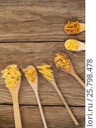 Купить «Spoons filled with varieties of pasta», фото № 25798478, снято 13 октября 2016 г. (c) Wavebreak Media / Фотобанк Лори