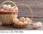 Купить «eggs on wooden background», фото № 25799906, снято 12 марта 2017 г. (c) Майя Крученкова / Фотобанк Лори