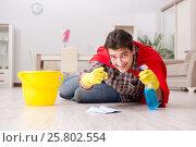 Купить «Super hero husband cleaning floor at home», фото № 25802554, снято 26 декабря 2016 г. (c) Elnur / Фотобанк Лори