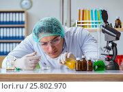Купить «Biotechnology scientist working in the lab», фото № 25802970, снято 28 ноября 2016 г. (c) Elnur / Фотобанк Лори