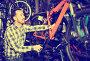 Man considers bicycle frame in store, фото № 25811754, снято 23 марта 2017 г. (c) Яков Филимонов / Фотобанк Лори