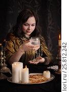 Купить «Divination with candle, focus on glass», фото № 25812242, снято 5 марта 2017 г. (c) Майя Крученкова / Фотобанк Лори