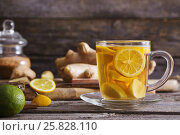 Купить «Ginger tea and ingredients on a grunge wooden background», фото № 25828110, снято 23 марта 2017 г. (c) Майя Крученкова / Фотобанк Лори