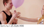 Young couple fooling like children with balloons. Стоковое видео, видеограф Илья Насакин / Фотобанк Лори