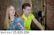 Купить «Happy and attractive young couple dance together», видеоролик № 25829206, снято 10 марта 2017 г. (c) Илья Насакин / Фотобанк Лори