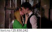 Happy and attractive young couple kissing. Стоковое видео, видеограф Илья Насакин / Фотобанк Лори