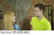 Купить «Happy and attractive young couple dance together», видеоролик № 25830602, снято 10 марта 2017 г. (c) Илья Насакин / Фотобанк Лори
