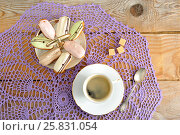 Cakes in the plate and coffee in a mug with spoon and sugar. Стоковое фото, фотограф Денис Иванов / Фотобанк Лори