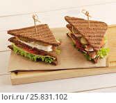 Two sandwiches from triangular pieces of bread with chicken breast. Стоковое фото, фотограф Денис Иванов / Фотобанк Лори