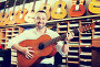 man selecting guitar at studio, фото № 25833250, снято 28 марта 2017 г. (c) Яков Филимонов / Фотобанк Лори