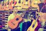 Friendly shopgirl helping male client to select guitar, фото № 25833254, снято 28 марта 2017 г. (c) Яков Филимонов / Фотобанк Лори