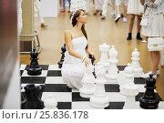 Купить «RUSSIA, MOSCOW - JUN 12, 2015: Woman dressed in white dress poses on floor-stand chess board in hall of Olympiysky sports complex during Sensation Wicked Wonderland show», фото № 25836178, снято 12 июня 2015 г. (c) Losevsky Pavel / Фотобанк Лори