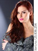 Купить «Pretty young woman with pink lips in grey dress poses in grey studio», фото № 25836254, снято 26 апреля 2015 г. (c) Losevsky Pavel / Фотобанк Лори