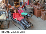 Купить «PARIS - MAR 9, 2015: Mother and daughter (with model releases) are in designer armchairs in Artplay, store expensive luxury items», фото № 25836258, снято 9 марта 2015 г. (c) Losevsky Pavel / Фотобанк Лори