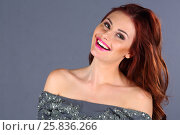 Купить «Pretty young woman with pink lips and long hair laughs in grey studio», фото № 25836266, снято 26 апреля 2015 г. (c) Losevsky Pavel / Фотобанк Лори