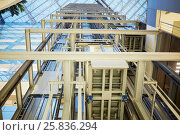 Купить «RUSSIA, KRASNOGORSK - DEC 12, 2014: Elevator cabin inside shaft in building of the House of Moscow Oblast Government. Construction of House was started in 2004 and ended in 2007.», фото № 25836294, снято 12 декабря 2014 г. (c) Losevsky Pavel / Фотобанк Лори