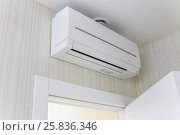 Купить «Air-conditioning, attached to wall, hanging over entrance door to apartment», фото № 25836346, снято 9 марта 2015 г. (c) Losevsky Pavel / Фотобанк Лори