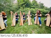 Купить «Ensemble of six young musicians play harps outdoors», фото № 25836410, снято 19 июня 2016 г. (c) Losevsky Pavel / Фотобанк Лори
