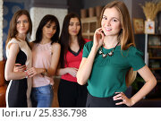 Купить «Young beautiful woman poses in cafe and three girls apprising look out of focus», фото № 25836798, снято 21 июня 2016 г. (c) Losevsky Pavel / Фотобанк Лори