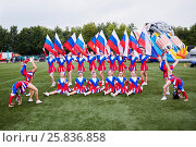 Купить «MOSCOW, RUSSIA - AUG 20, 2016: Team of girls cheerleaders poses at playground during the Moscow City Championship of combat deployment in Luzhniki», фото № 25836858, снято 20 августа 2016 г. (c) Losevsky Pavel / Фотобанк Лори