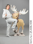 Купить «Woman in white protective suit of synthetic paper poses with cardboard moose», фото № 25836938, снято 14 декабря 2014 г. (c) Losevsky Pavel / Фотобанк Лори