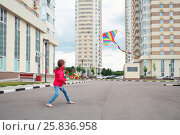 Купить «Girl in red jacket and blue jeans let kite on local area of high-rise buildings», фото № 25836958, снято 18 июня 2014 г. (c) Losevsky Pavel / Фотобанк Лори