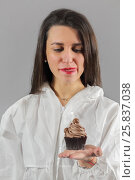 Купить «Half-length portrait of woman holding piece of tasty chocolate cake and looks with desire to eat this cake, on gray background», фото № 25837038, снято 14 декабря 2014 г. (c) Losevsky Pavel / Фотобанк Лори