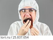 Купить «Half-length portrait of woman biting the piece of tasty chocolate cake and looking at us. Isolated on gray background», фото № 25837054, снято 14 декабря 2014 г. (c) Losevsky Pavel / Фотобанк Лори